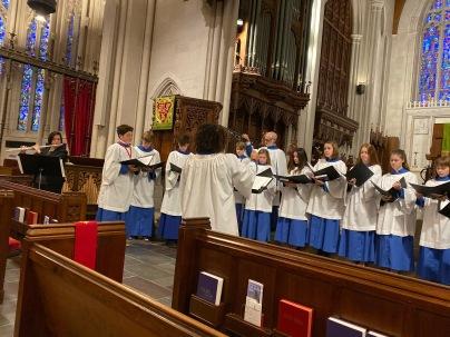 Amy accompanies children's choir